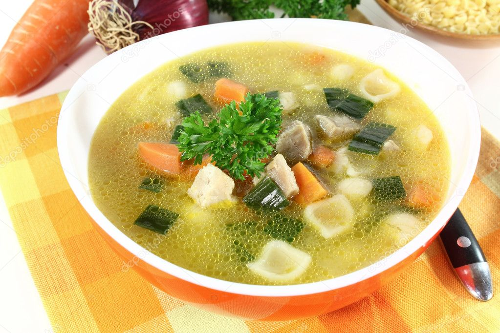 Chicken soup with vegetables and parsley in a bowl  Stock Photo #6542634