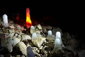 Multicolored ice stalagmites in the cave. — Stock Photo