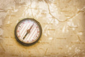 Compass over the old map — Stock Photo