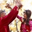 Young couple enjoying the falling leaves — Stock Photo #5855194