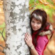 Beautiful girl's portrait near tree — Stock Photo