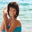 Young woman with seashell — Stock Photo