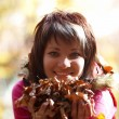 Beautiful girl's portrait with leaves — Stock Photo