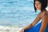Young woman on th beach — Stock Photo