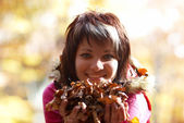 Beautiful girl's portrait with leaves — Stok fotoğraf