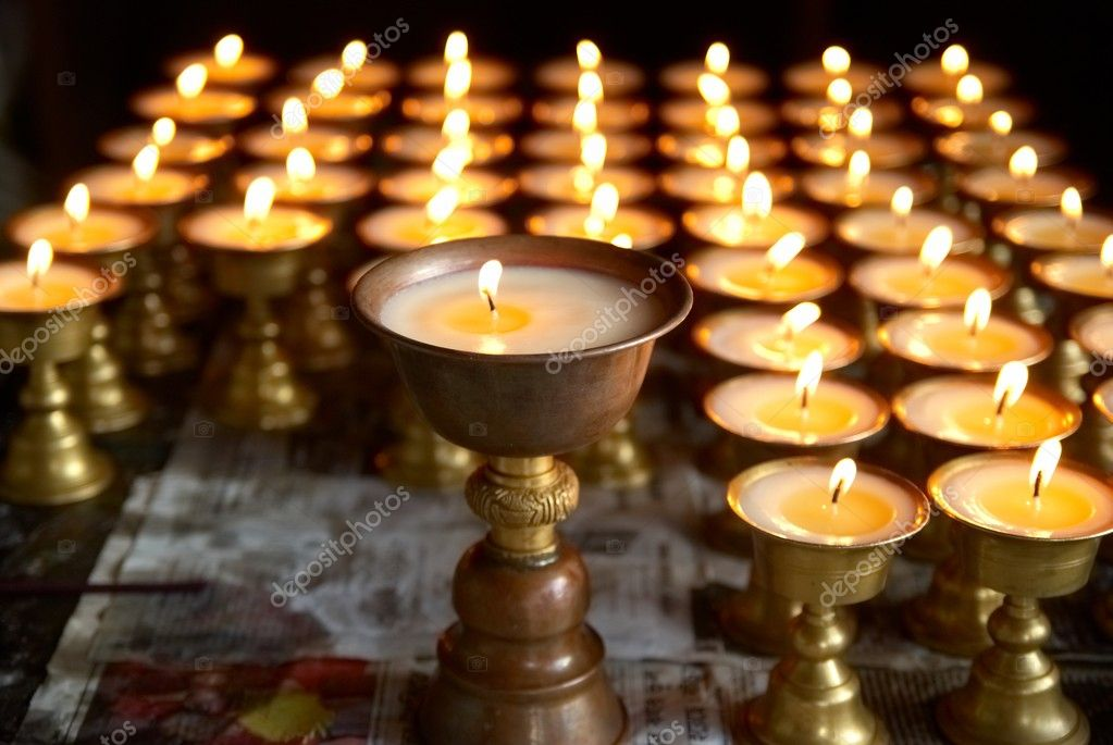 Rows of candles in the indian temple — Stock Photo #6062495