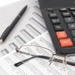 Pen, glasses and calculator — Stock Photo