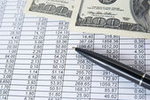 Money with financial table — Stock Photo