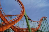 Double Loop on a Roller Coaster with train just passing — Stock Photo