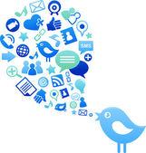 Mavi kuş ile sosyal medya simgeler — Stok Vektör
