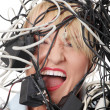 Mature businesswoman's screaming in cables. — Stockfoto