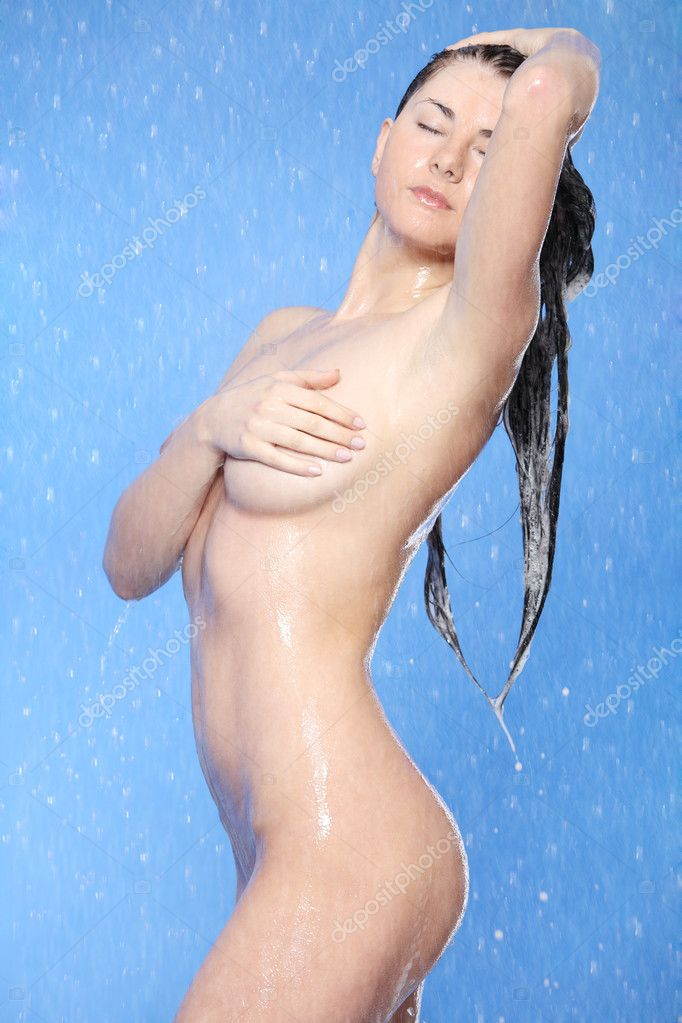Beautiful young woman taking shower    #5427678