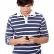 A handsome happy man using mobile phone. — Stock Photo #5795021