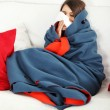 Stock Photo: Young woman at home having flu.