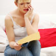 Worried woman's reading letter. — Stock Photo #5795353