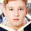 Young teen man is reading a book — Stock Photo #5795518