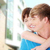 Happy young couple after buying house — Stock Photo