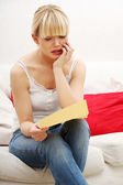 Worried woman's reading letter. — Stock Photo