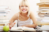 Young student woman with lots of books studying for exams. — Stock Photo