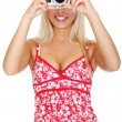Woman holding a micro four thirds photo camera. — Stock Photo