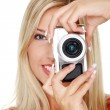 Woman holding a micro four thirds photo camera. — Stock Photo #6012524