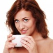 Young woman is having her tea/coffee — Stock Photo