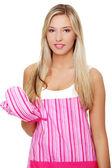 Beautiful happy young blond woman wearing kitchen apron — Stock Photo