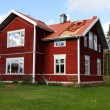 Scandinavian wooden cottage — Stock Photo