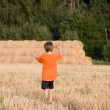 Boy goes to the cant field — Stock Photo #5459953