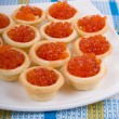 Tartlets with red caviar — Stock Photo #5603203