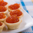 Tartlets with red caviar — Stock Photo #5603230