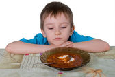 Boy refuses to eat soup — Stock Photo