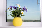 Bouquet of flowers on the window — Stock Photo