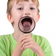 Boy with magnifying glass — Stock Photo