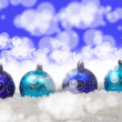Blue christmas balls with snow — Stock Photo