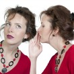 Woman whispering a secret — Stock Photo #5582819