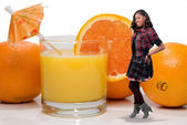 Black Teenager with Orange Juice — Stock Photo