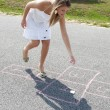 Woman Playing Hopscotch — Stock Photo