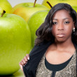 Stock Photo: AfricAmericTeenager and Granny Smith Apple