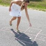 Woman Playing Hopscotch — Stock Photo
