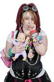 Vacker kvinna och baby doll — Stockfoto