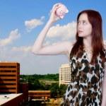 Woman holding piggy bank — Stock Photo #6314821