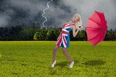 žena hospodářství deštník — Stock fotografie