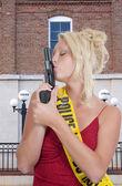 Female Detective Kissing Gun — Stock Photo