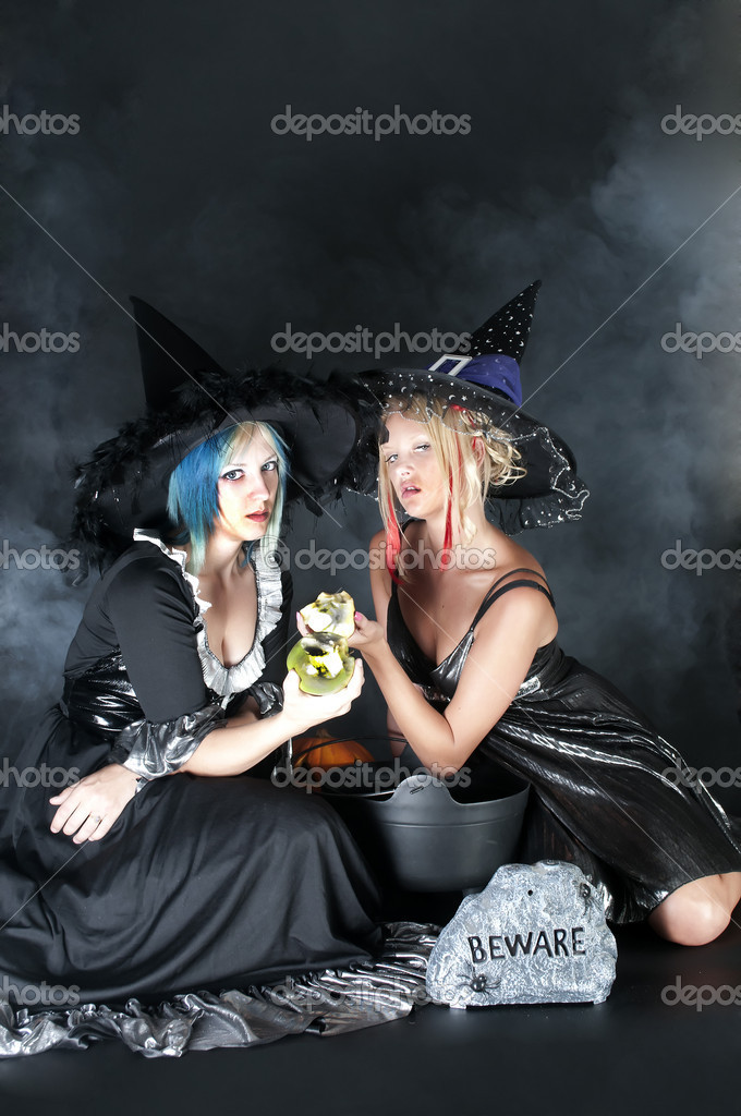 A couple of beautiful young women witches on Halloween — Stock Photo #6314655
