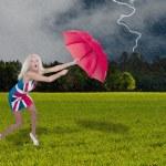 Woman Holding Umbrella — Stock Photo #6654456