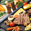 Barbecue, prepared beef meat and different vegetables and mushrooms on gril - Stock Photo