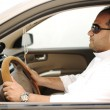 Arabic man driving a car — Stok fotoğraf