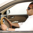 Arabic man driving a car — Stock Photo