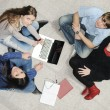 Creative group of students sitting and working together — Stock Photo #6150234